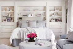 Small white wooden headboard with built-in shelves