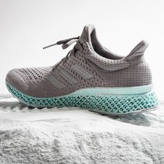 Adidas' concept trainer features an upper made using waste plastic filtered out of the oceans and a 3D-printed midsole created from recycled fishing nets