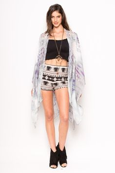 I love this coverup with its soft purple elements adding a soft element to her tribal outfit!