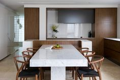 Save space with an island and table in one. The innovative kitchen in this Sydney home features an island counter on one side, with built-in seating and a ...