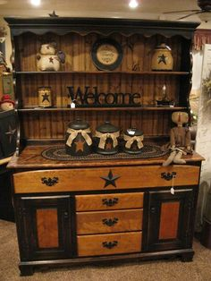 I love this hutch and all of the neat things stored on it. I found it on Facebook at Primitive Country Treasures, but you can't pin directly from there. The shops is definitely worth looking into. :) #PrimitiveHomes #PrimitiveCountryDecorating