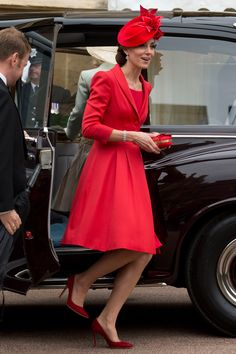 The Duchess of Cambridge continued fashionable week in a red Catherine Walker coat   - HarpersBAZAAR.co.uk