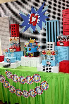 cool presentation for the cake and cake pops. ( fun box buildings! ) I really like the happy birthday banner too.