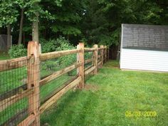 3 rail split rail fencing - decorative with wire fence to keep dogs in yard.