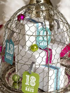 Jessica Wilcox of Modern Moments Designs used a vintage chicken-wire cloche dome as the base for her decorative advent calendar. To make your own, add presents, colorful ornaments and ribbons underneath the dome. On the outside, attach the Christmas countdown tags to represent the number of presents inside. Each day, remove a tag and open a present until Christmas arrives.