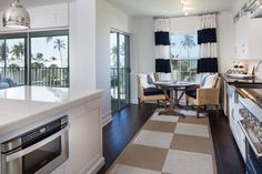 Coastal condo renovation - great use of texture and color.  The ocean view doesn't hurt either!!  Cloisters Condo | Milestone Development & Design, Inc.