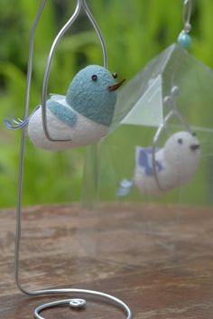 Birds of silk cocoons. The blue one is dyed with fresh leaves of Japanese Indigo (Polygonum tinctorium ),