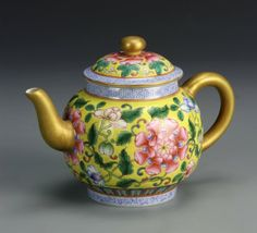 China, Famille Rose teapot, with a bright yellow ground color, decorated with an brightly colored overall floral pattern, with marking. Width 7 1/ 2 in., Height 5 in.