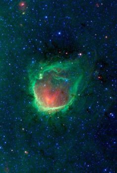 Image of a glowing emerald nebula in the Milky Way