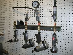 Air tool storage:  - Could mount inside a cabinet  - Could add a pullout roller and mount bar on it