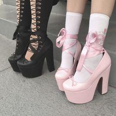 Black lace up platform heels and pastel pink lace up platform heels