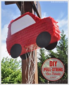 Here is another fun detail from the Race Car Birthday Party: a bright red car piñata! Since it was a 2-year-old party, we decided to go the safer route and make a piñata that didn't require any bli...
