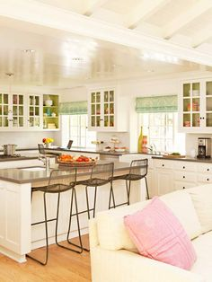 Love this kitchen!  Also love the cabinets being painted on the inside, the glossy ceiling, the pretty curtains, the stools... just a happy kitchen.