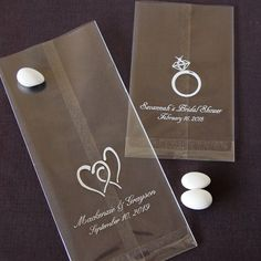 Personalized Wedding Cellophane Bags by Beau-coup you could get these and fill them with personalized M&Ms