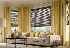 Hunter Douglas Wood Blinds with yellow drapes in a living room setting. Combining blinds, shades or shutters with drapes, curtains or valances makes space a focal point - true window dressings. Window Treatments, Yellow Drapes, House Blinds, Blinds, Fabric Shades, Interior Design, Window Coverings, Window Styles, Custom Window Treatments