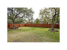 alternating wood fence panels