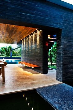 Clunny House | A Sustainable Modern Home Design with Inner Tropical Water Garden by Guz Architects