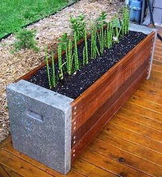 Concrete and wood planter.  Would work well converted to a bench