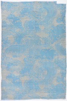 """Textile, """"Collection: An Homage to Jim Thompson"""", 1972. Jack Lenor Larsen, designer.Medium: silk. Technique: screen printed with discharge on dyed plain weave. Gift of Jack Lenor Larsen. 1973-54-1-a,bu  Cooper-Hewitt Museum.  Length of printed silk with stylized waves and spindrift reminiscent of Japanese katagami stencil resist textiles. Hand printed with discharge dyes, giving a white pattern on a blue ground."""
