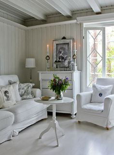 White Living Room opens everything up in the room, making it appear larger. A painted chest of drawers adds a lot of storage.