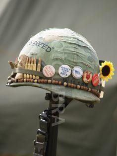 Vietnam Helmet Art. - buttons read 'matzoh balls not bombs' 'draft beer not boys'