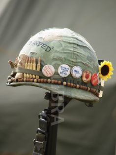 Vietnam Helmet Art. - buttons read 'matzoh balls not bombs' 'draft beer not boys'