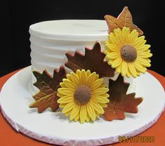 Horizontal lined one tier cake with handmade sunflowers and fall leaves One Tier Cake, Traditional Wedding Cakes, Fall Leaves, Tiered Cakes, Sunflowers, Desserts, Handmade, Food, Autumn Leaves