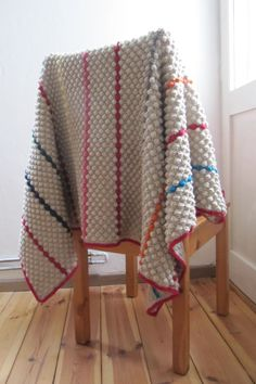 Ta-daaah (as Natasja would say) - I have finally finished the Bobbly Blanket. Whoo-hooo!! It's very heavy (1 kilo = 2.2 lbs) and very beautiful. Plus, the feel of the bobbles is beyond description....