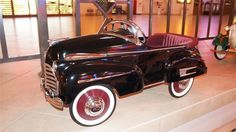 """This <a href=""""http://www.barrett-jackson.com/Archive/Event/Item/Stylish-1941-Buick-Sad-Face-pedal-car-restored-with-great-attention-to-detail-179693 """" target=""""_blank"""">1941 Buick """"Sad Face"""" pedal car</a> sold for $6,325 as part of the Barrett-Jackson sale of the Pratte Collection."""