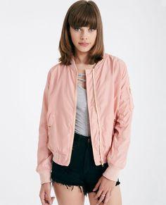 <p>A classic bomber jacket with a soft and silky woven body, ribbed knit trim, button snap front pockets, a zip pocket on the sleeve, and an exposed front zipper.</p>  <p>Model wears a size small.</p>  <ul> <li>Mock Neckline</li> <li>Zip Front Closure</li> <li>Lightweight</li> <li>Lined</li> <li>Long Sleeves</li> <li>Polyester</li> <li>Machine Wash</li> <li>Imported</li> </ul>