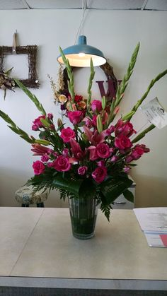 This all pink arrangement features gladiolas, roses, spray roses, and lilies. www.bloominggalsbouquets.com http://on.fb.me/1BT3HNz