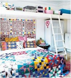 Love the patterned duvet and the staires to the top of the shelf  =^.^=