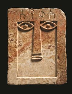 South Arabian alabaster stele,1st millennium BC (20.3 cm). The stele depicts an abstract face with carved eyes, a long nose, and a small fleshy mouth; above, an inscription in Minaic gives the name of the deceased: 'Wysl', probably equivalent to the modern Arabic name Uways.