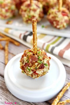 Pimento Cheese and Bacon Mini Cheese Ball Bites ~ mini cheese balls of homemade pimento cheese are rolled in a coating of crispy bacon, toasted pecans, and minced fresh jalapeños and then speared with a pretzel stick for fun, easy-to-eat appetizers, perfect for game day or any get-together! | FiveHeartHome.com