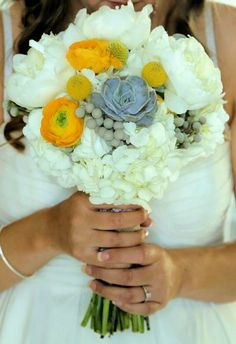 Hand-Tied Bouquet Featuring Peonies and Ranunculus with brunia berries and gray succulents