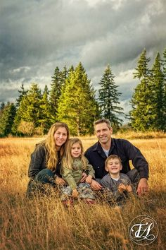 Family photo taken in golden field at sunset. By TAustin Photography