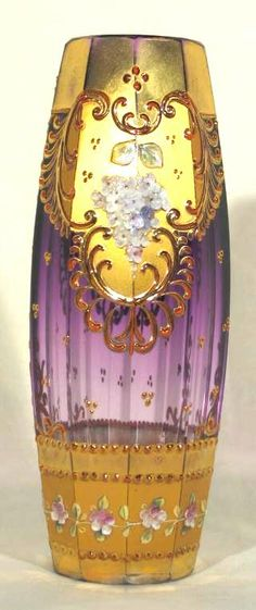 Moser amethyst-glass vase with the typical run of the color from a dark amethyst to clear, Karlsbad around 1880-1890. Heavy high quality crystal faceted cut to a 10-sided form and then hand decorated with relief enamel and gilding