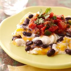 Scrambled Eggs with black beans, cheddar, and salsa.