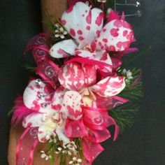 Drip spray paint on a white orchid for a funky new look for prom or wedding corsages