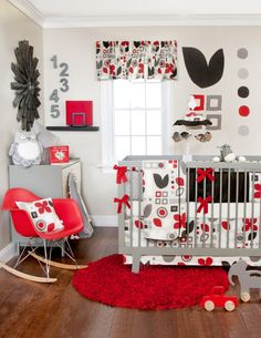 Red is such an attention-getter. The gray & black accents really make this room POP.