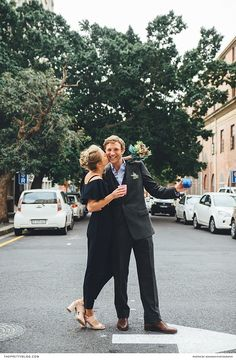 A simplistic modern wedding celebration with the bride in a black jumpsuit with frilled details and the groom in a grey suit and light blue shirt! Fashion 2017, Latest Fashion Trends, Outdoor Wedding Inspiration, Stylish Couple, Light Blue Shirts, Little Fashion, Groom And Groomsmen, Black Jumpsuit, Love And Marriage