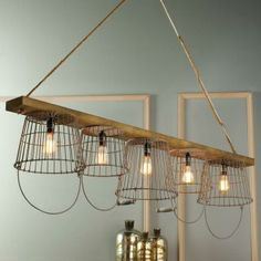 Rustic Wire Basket and Wood Chandelier To market, to market! Wood, wire, and rope form a unique chandelier with inspiration from market baskets and rope swings! A great kitchen island chandelier or use over a rustic table. Rustic Chandelier, Wood Chandelier, Diy Chandelier, Home Lighting, Rustic Chandelier Lighting, Rustic Lighting, Wooden Pendant Lighting, Wire Basket Chandelier, Home Decor