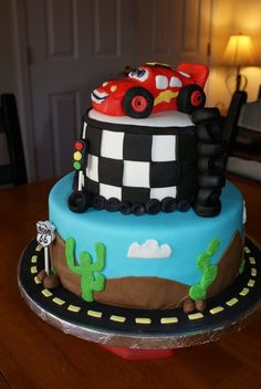 Cars cake for a three year old.  WASC with strawberry jam filling, covered in buttercream then fondant.  All accents are fondant or royal icing.  Thanks for looking!