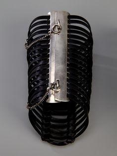 Ann Demeulemeester Cuff Bracelet in Black -Black leather bracelets from Ann Demeulemeester featuring multi black straps and a silver-tone fastening.