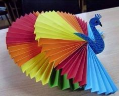 This page includes a lot of folding paper crafts for kıds,preschoolers,kindergarten. folded paper caterpillar craft for kids paper toys for kids paper folding skills how to make origami for kids easy origami: models especially for beginners and kids Animal Crafts For Kids, Paper Crafts For Kids, Craft Activities For Kids, Fun Crafts, Art For Kids, Diy And Crafts, Peacock Crafts, Creative Arts And Crafts, 3d Origami