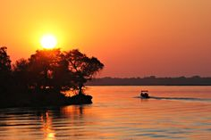 One of the best places to experience a beautiful African sunset - the Chobe River in Botswana. #bestafricavacations