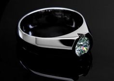 Ideal Cut Round Brilliant in Half Bezel Ring    Posted by John Pollard