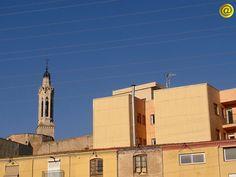 Imatge des del Pont d'En Cabré, amb els blocs de pisos nous del principi del carrer de La Candela. Feta el 15 de maig de 2014 a 1/4 de 8 de la tarda.
