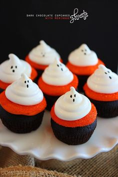 Recipe For Dark Chocolate Cupcakes with Meringue Ghosts - I created these spooky ghost cupcakes with glittery orange frosting and fluffy white meringue ghosts.
