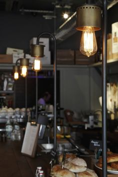 nice pipe lighting attached to bar top not hanging from ceiling anchors the bar with nice low light.